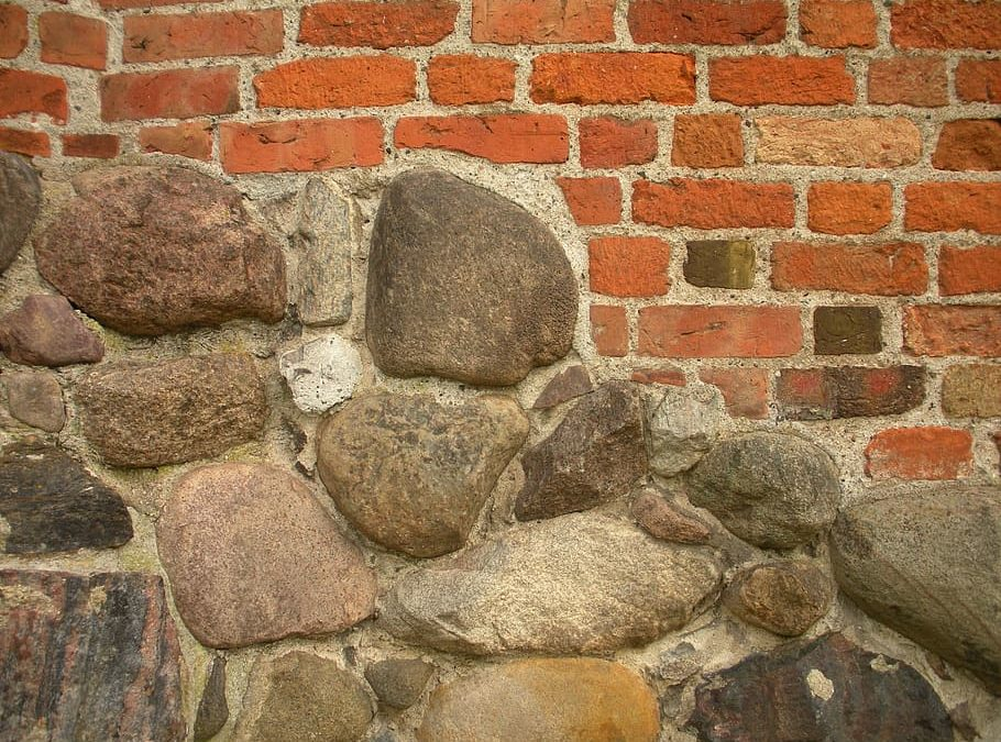 orange and brown brick wall and stone cladding